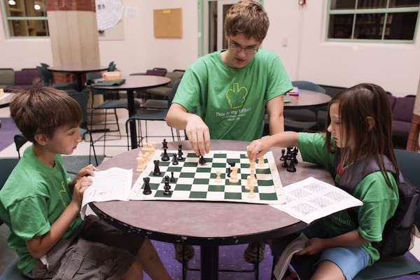 Chess analysis with camp counsellor.