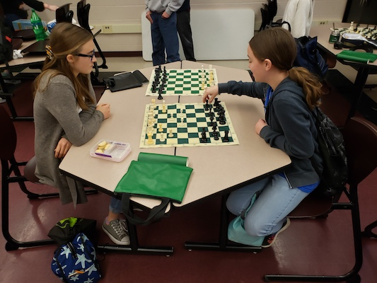 Future Dragons playing chess at shadow day.